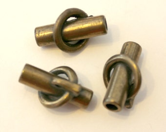 3 Vintage brass buttons with tube encircled ring design.