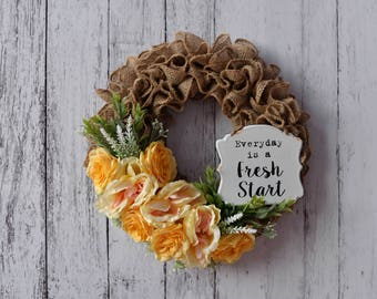 Burlap wreath with Yellow flowers and a vintage rustic sign