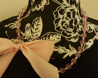 Pink beaded bow necklace