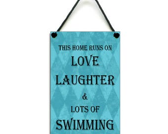 This Home Runs On Love Laughter & Swimming Gift Handmade Home Sign/Plaque 460