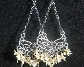 Real snake vertebrae chandelier earrings.