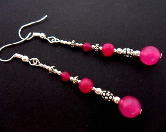 A pair of pretty bright pink jade   bead silver plated long dangly earrings.