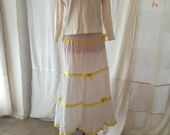 White Indian skirt with yellow loops and small blossoms