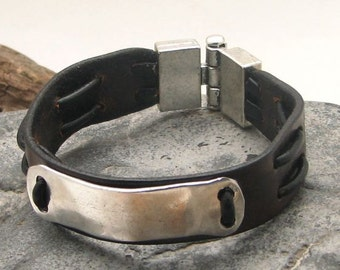 Men's bracelet leather. Brown leather bangle bracelet with hammered metal work buckle and  silver plated clasp
