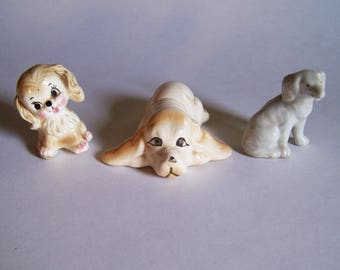 Three Miniature Dog Figurines - One Made in Japan, One Made in China and One Unmarked Dog Figurine - Tallest is 2 1/4 Inch