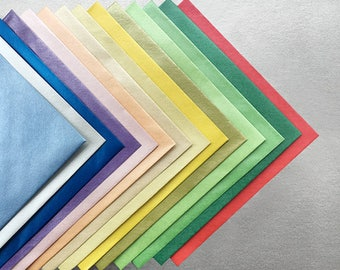 Pack of 12 or 36 square pearlescent envelopes. 135mm x 135mm. Ideal for card making, invitations. Shimmer envelopes. 14 colour options.