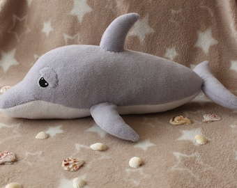 Sleepy dolphin plush toy