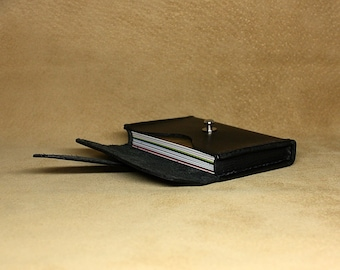 Hand-stitched credit or business card holder in black leather with nickel-plated stud
