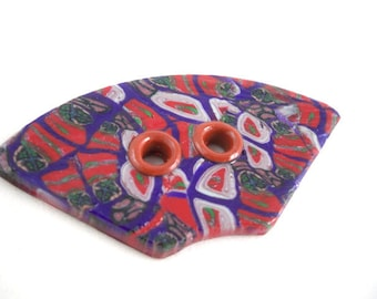 Large focal button fan shaped with grommets red and purple