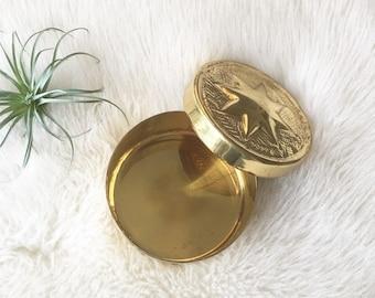 Vintage brass trinket box with star design
