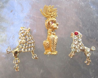Cute collection of 3 vintage gold tone and rhinestone poodle brooches - estate jewelry lot