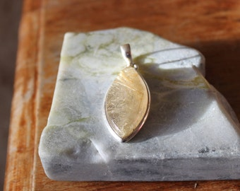 Rutilated quartz and Silver pendant