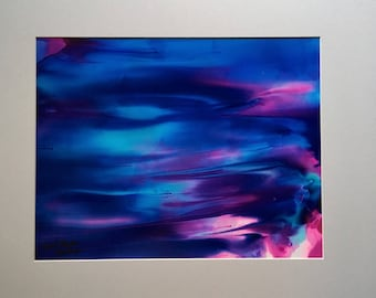 Abstract alcohol ink painting in vibrant blues and pink