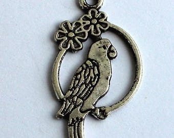 Set of 4 silver Parrot pendants
