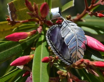 Handmade sterling silver feather pendant featuring a chevron amethyst gemstone