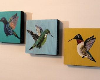 Hummingbirds on wood frames
