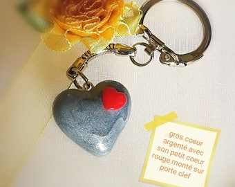 Big silver heart with its tiny red heart mounted on keychains