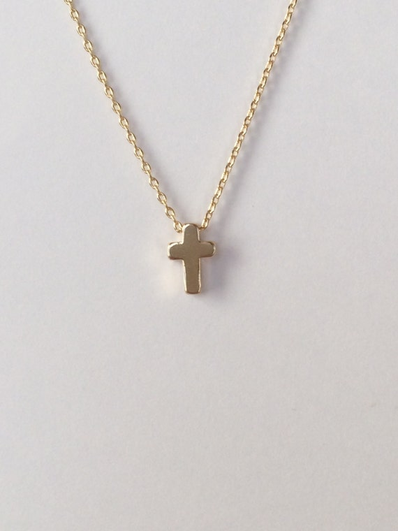 Tiny gold cross necklaceall cross necklaceidal party small cross necklaceidal party aloadofball Gallery