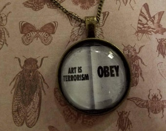 Obey pendant necklace