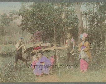Wealthy woman in kago chair with servants antique hand tinted photo Japan