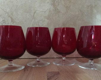 Four beautiful, ruby red liqueur glasses