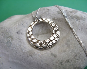Fine silver disc necklace with reptile skin imprint