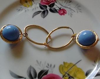 Gold Pierced Earrings:  Blue circulating Bead.
