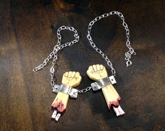 Severed Arms in Manacles and Chains - scroll saw necklace - a grim handmade product. FREE GLOBAL SHIPPING