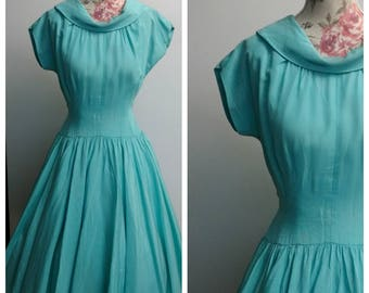 vintage 1950s aqua party dress with full circle skirt