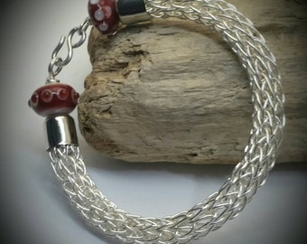 Viking weave bracelet in silver filled wire with hand made glass beads. Will fit wrist sizes 7 to 7.5 inches