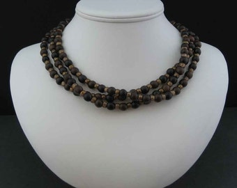 Wood and Iridescent Brown Glass Three-Strand Necklace