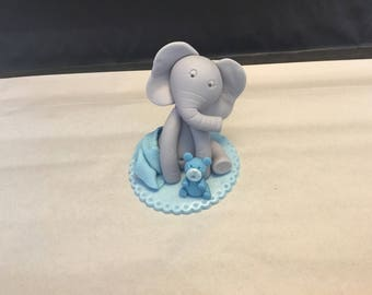 Baby elephant with bear and base cake topper made out of fondant