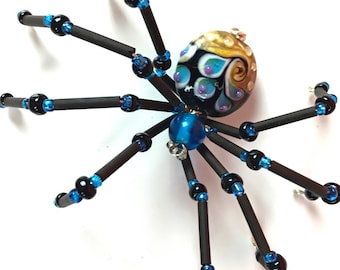 Beaded Wire Spider Hand Crafted in Blue and Black with Accents of Purple and Gold