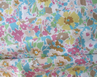 Fabric rose flower, cotton with multicolored flowers pastel colors.