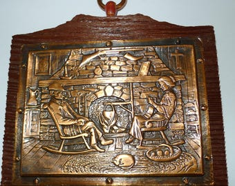 """Vintage A.Nadeau embossed copper plate ..Couple by a fireplace   5""""  x  4"""""""