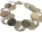 Button Disc Bracelet...