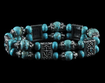 Gorgeous stretchy turquoise Howlite and silver plate beaded bracelet
