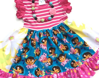 Dora the Explorer dress girls toddler birthday Pink Momi Boutique custom ruffle vacation dress