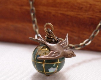 Its A Small World Glass Globe And Swallow Necklace