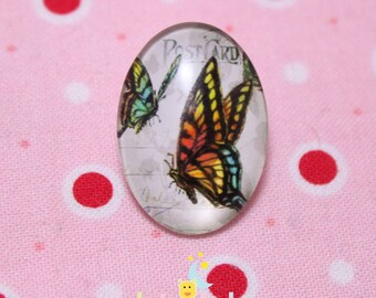 Glass cabochon oval pattern multicolored butterflies 18 / 25mm