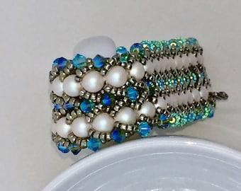 Patricia Bracelet:  Blue Swarovski crystals, white Swarovski pearls.  Swarovski box clasp.  7.25 inches long.  Luxurious!