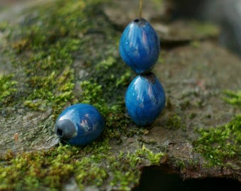 Raku beads - 2 Beautiful oval beads blue and black -