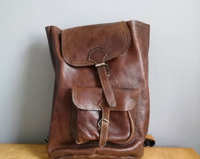 Featured listing image: Large vintage leather backpack / brown chestnut leather backpack / unisex leather rucksack / 70s leather backpack / big backpack purse /