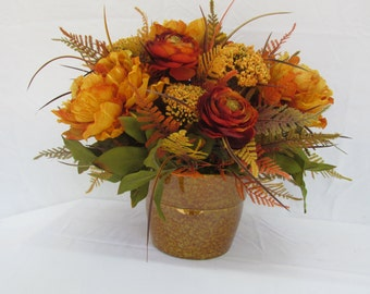 harvest basket of fall flowers pumkins and squash