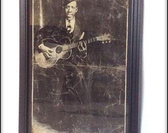 Hand aged reproduction of legendary bluesman Robert Johnson in frame.