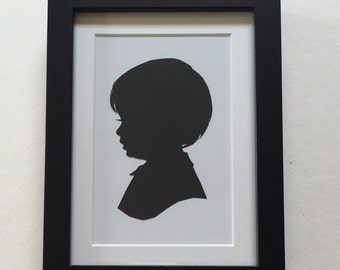 FRAMED Custom Silhouette Portrait: 5x7, Black Silhouette, White Background, Complete in Black Rectangular Frame.