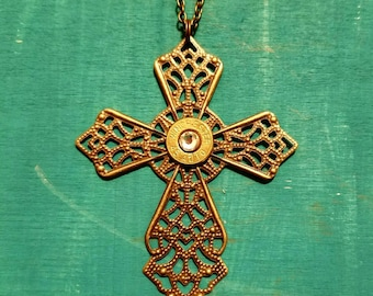 Bronze cross necklace with a 45 caliber casing and a crystal swarovski crystal