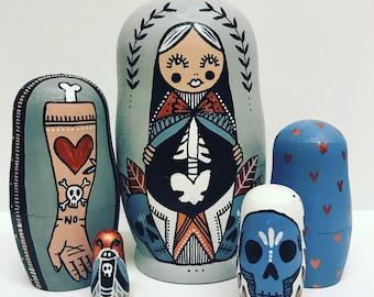 Russian nesting dolls, matryoshka dolls in dolls, tattoo illustration dolls, wooden babushka dolls
