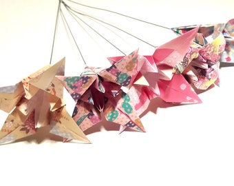5 lilies made of paper folding origami on steel rod