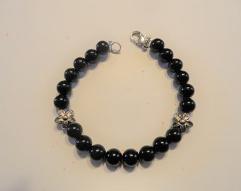 Bracelet Made With Black Glass Beads Flower Spacers in Middle